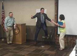 Ross-Pike ESD Superintendent Steve Martin (center) is handed a golf ball by Dawn Wallace (right), a curriculum instructor from the South Central Ohio ESC, while Wheelersburg Superintendent Mark Knapp (left) watches. This exercise challenged teams to work