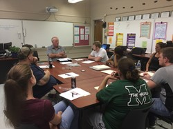 Dan Montavon, Adult Diploma Coordinator at the Scioto County Career Technical Center, talks to students of the Aspire program in New Boston.
