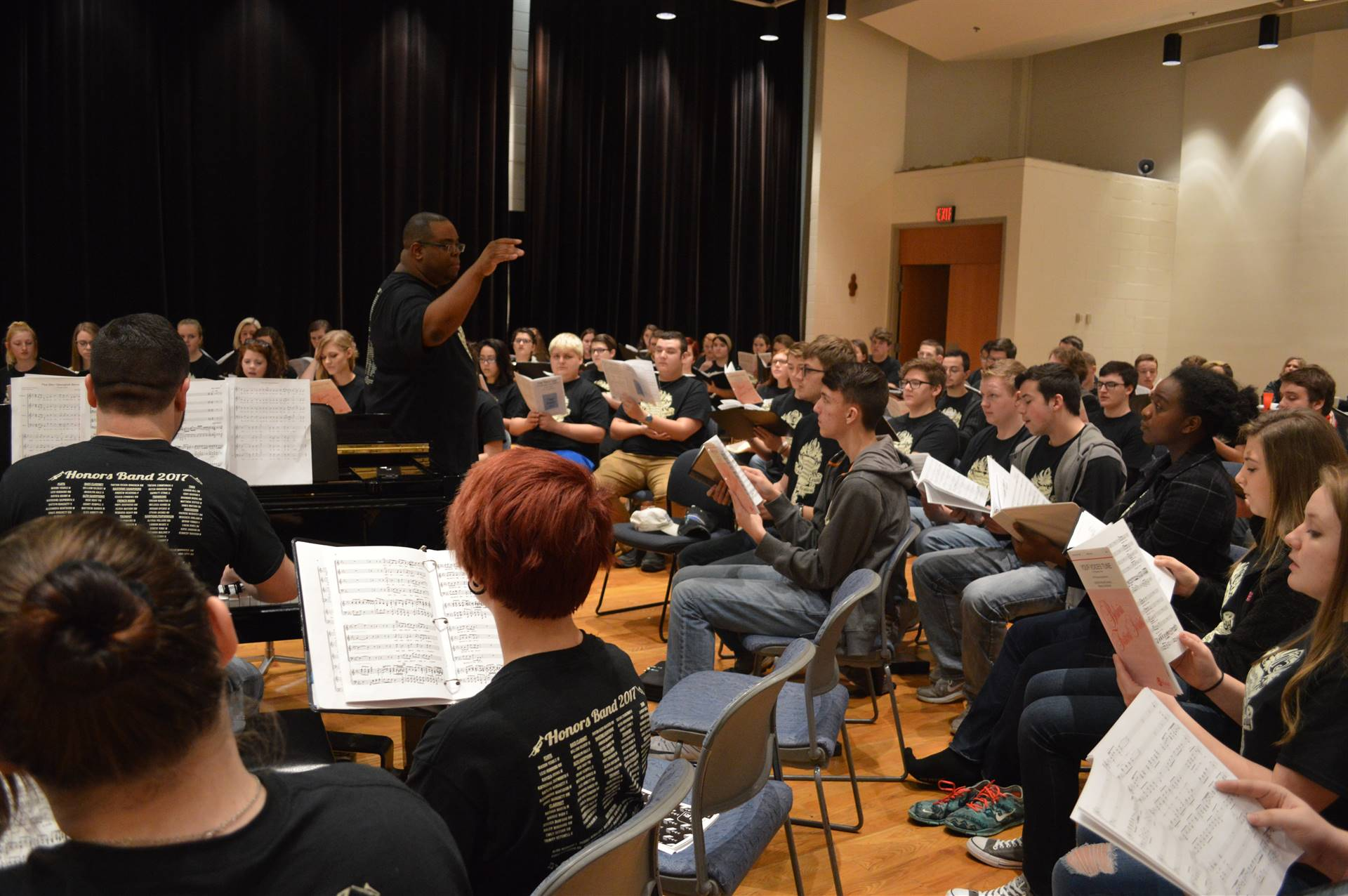 Choir rehearsing with Guest Conductor, Dr. Roosevelt Escalante